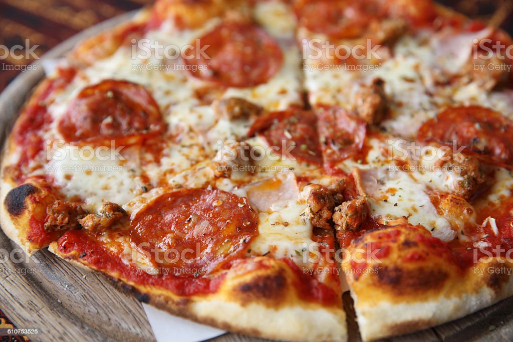 pepperoni pizza on wooden stock photo