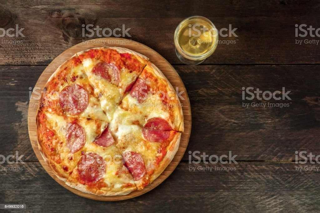 Pepperoni pizza with white wine, and place for text stock photo