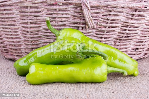 istock peppers and basket on burlap 594447170