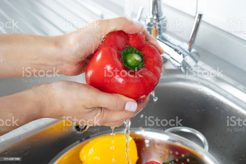 Peppers Being Washed In A Kitchen Sink Stock Photo Download Image Now Istock