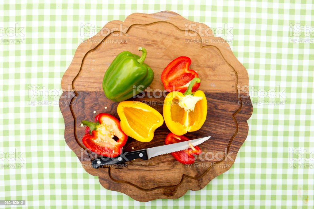 Peppers - Capsicum cut on wooden board royalty-free stock photo