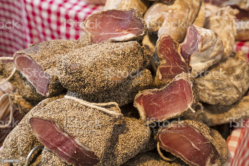 Pepper's Ham sold to the cut on a market stall. stock photo