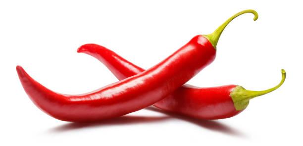 paprika's op wit - spaanse peper stockfoto's en -beelden