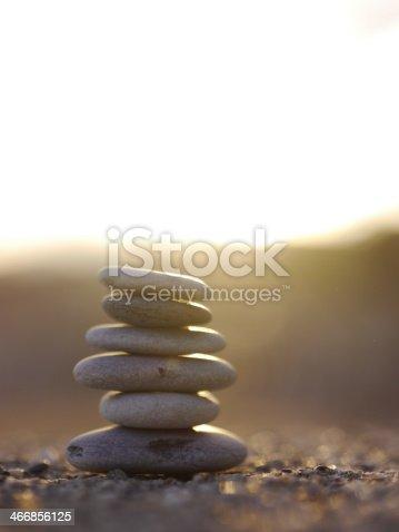591835714 istock photo pepple balance beach 466856125