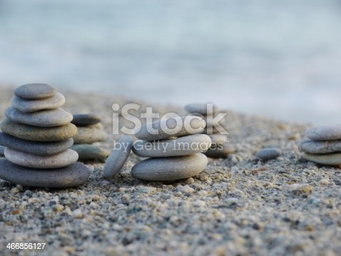 591835714 istock photo pepple balance beach 466856127