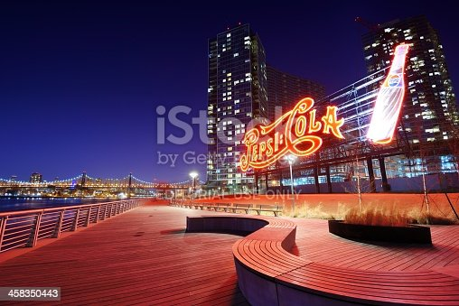 New York, USA - April 5, 2013: The Pepsi-Cola sign at Gantry Plaza State Park illuminates the riverfront promenade. Opened as a park in sections beginning in 1998, the northern section was formerly a Pepsi Bottling Plant.