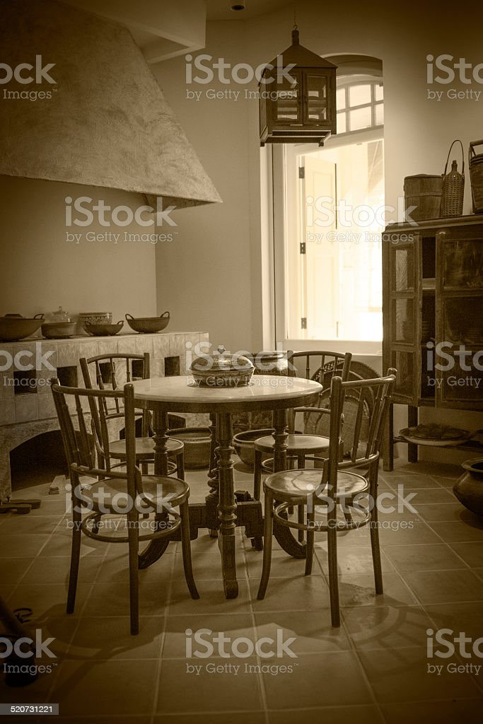 Peranakan old kitchen and dinning room- sepia tone stock photo
