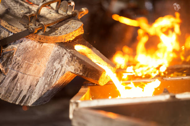 perator pouring molten metal in automatic casting line in foundry factory - metallurgy stock photos and pictures