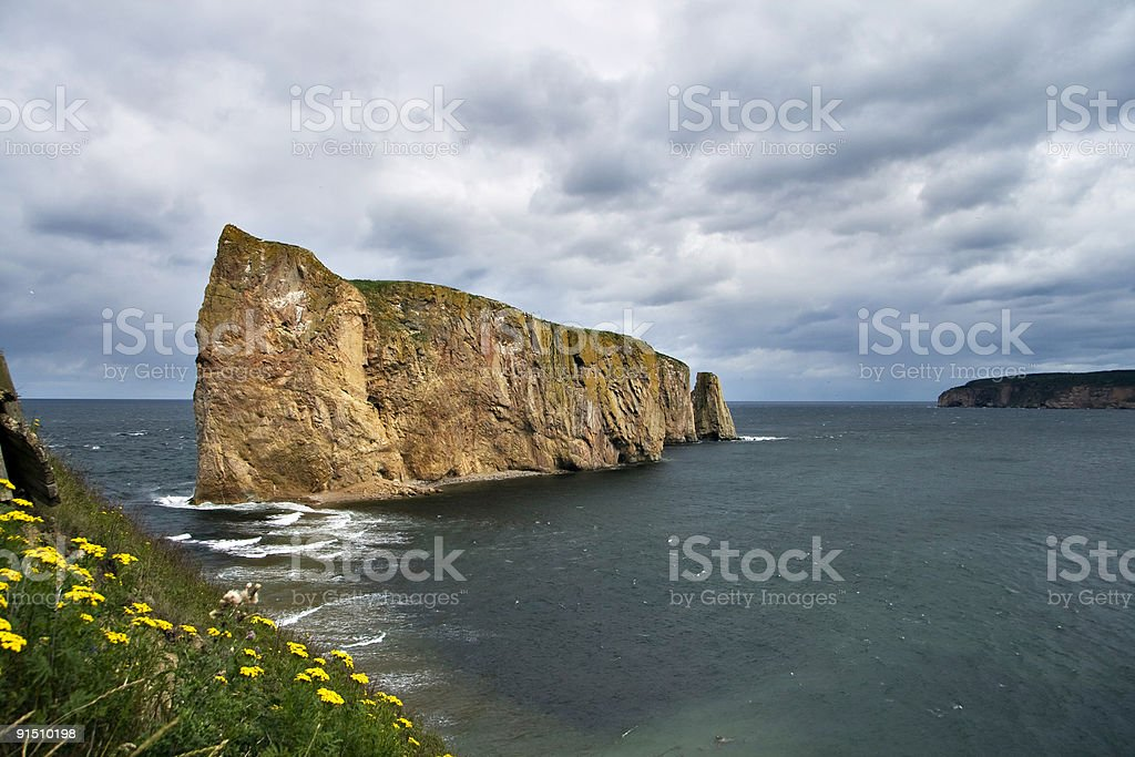 Perce Rock sideways on a cloudy day royalty-free stock photo