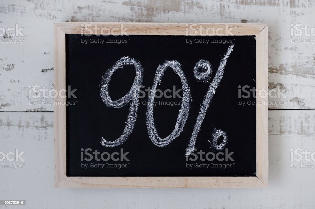90 percent discount. Blackboard with text '90%'. Special offer stock photo