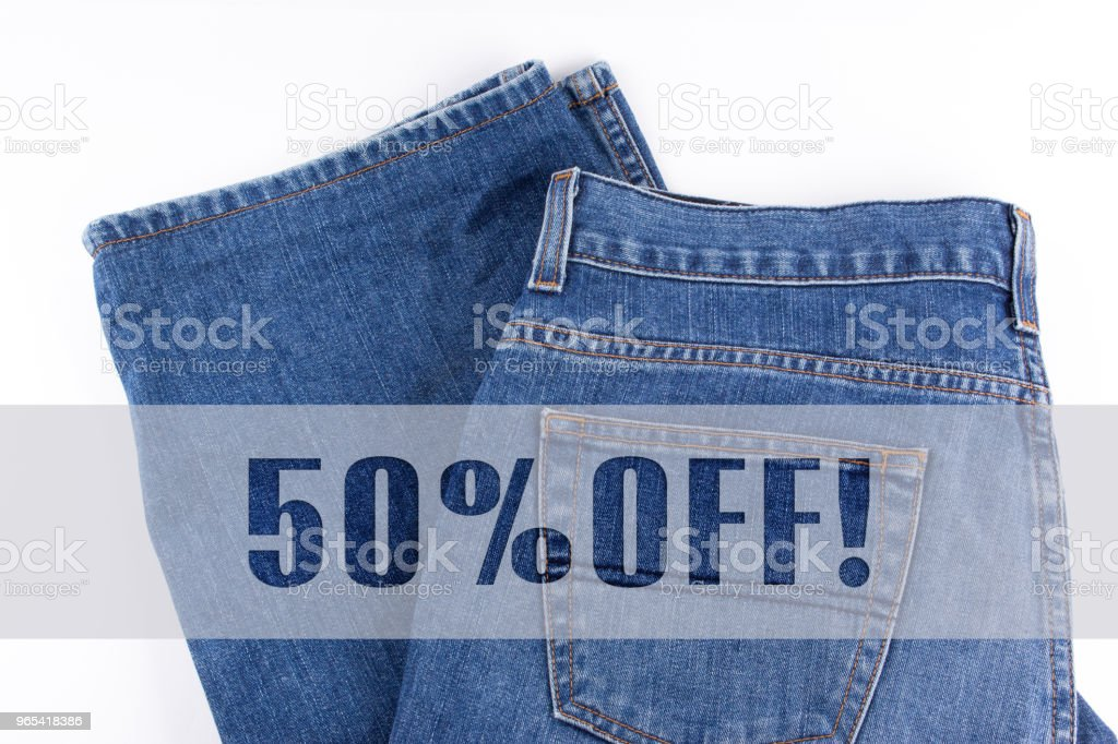 50 percent OFF written on blue jeans zbiór zdjęć royalty-free