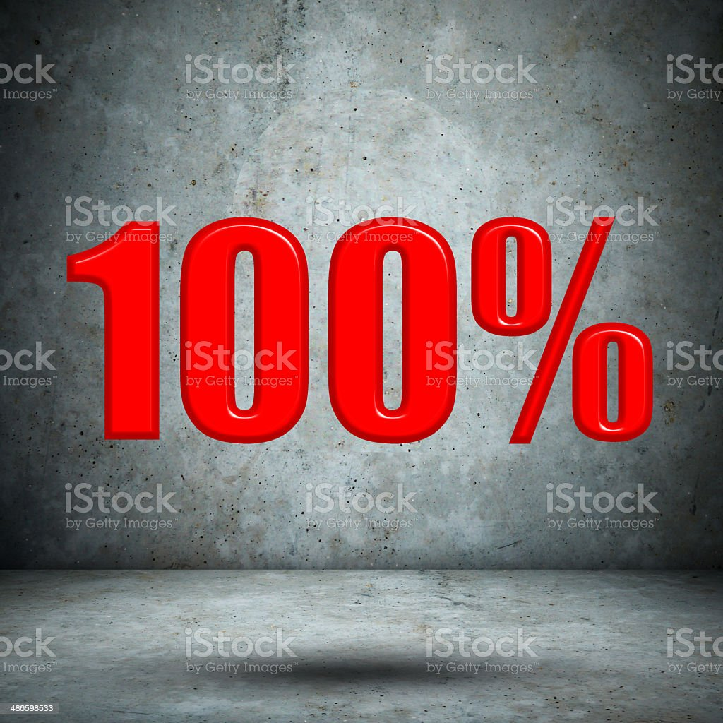 100 percent on concrete wall royalty-free stock photo