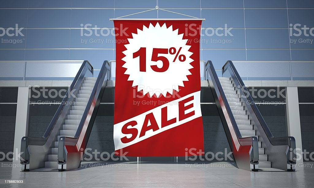 15 percent sale advertising flag and escalator royalty-free stock photo