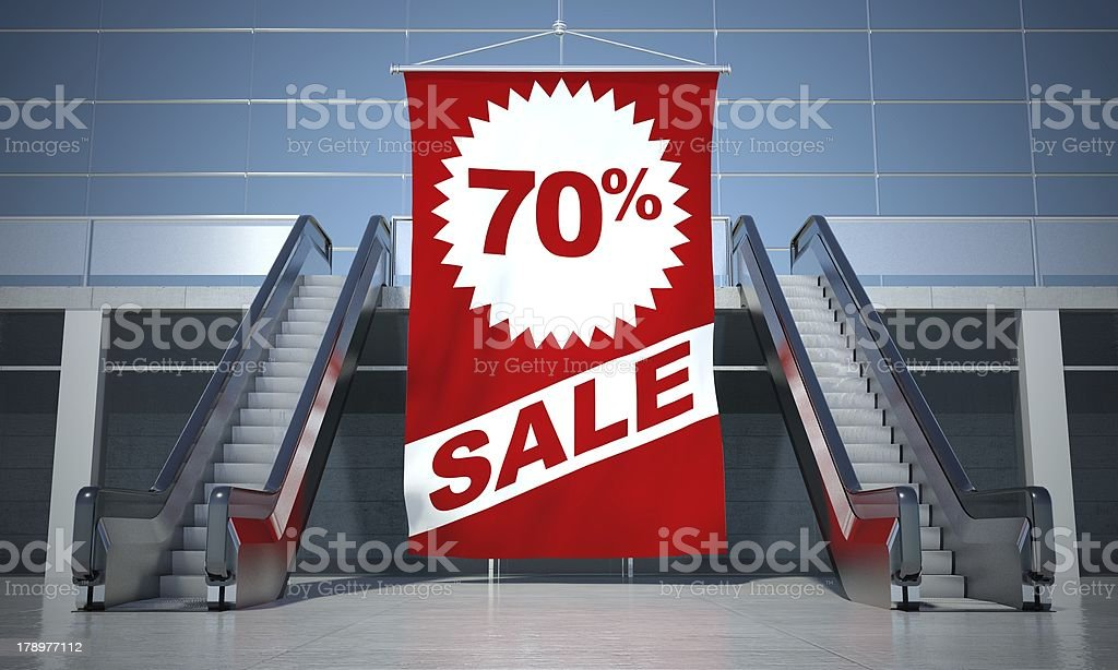 70 percent sale advertising flag and escalator royalty-free stock photo