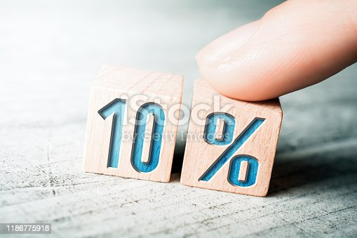 1048940572 istock photo 10 Percent Sale Discount Formed By Wooden Blocks And Arranged By A Female Finger On A Table 1186775918