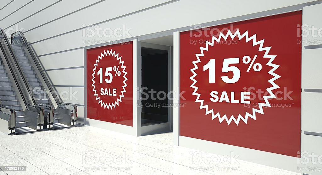 15 percent sale on shopfront windows and escalator royalty-free stock photo