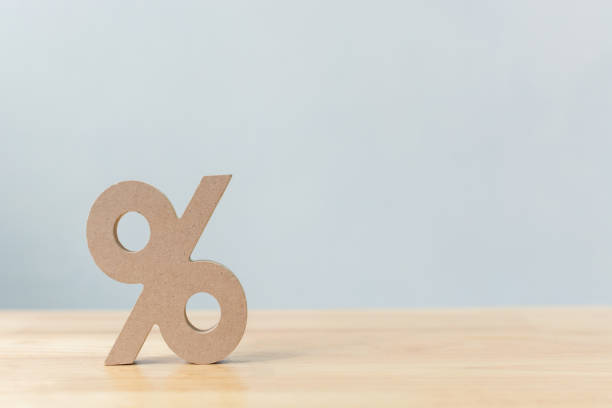 percentage sign symbol icon wooden on wood table with white background - interest rate stock photos and pictures