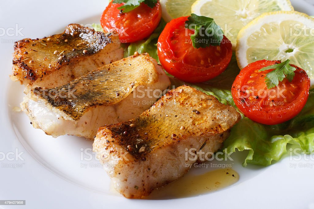 perch fried fillet with vegetables. Horizontal close-up stock photo