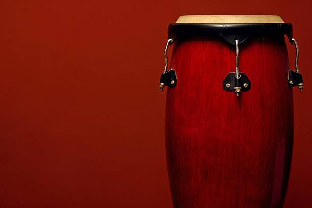 percussion instrument on red - reggae stok fotoğraflar ve resimler