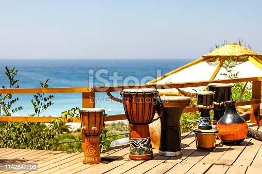 Percussion instruments in row over the blue sea