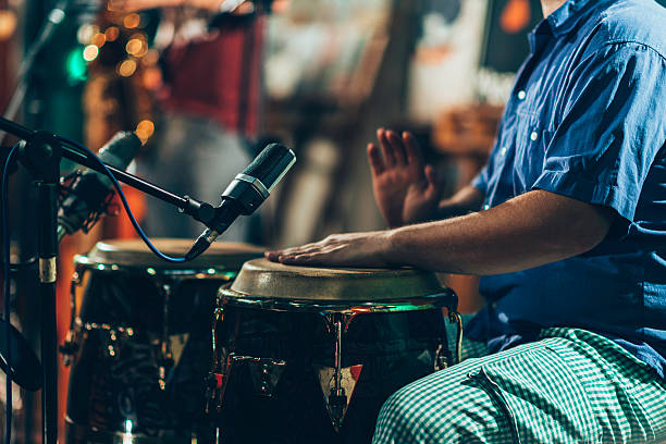 Percussionist Percussionist at concert drum percussion instrument stock pictures, royalty-free photos & images