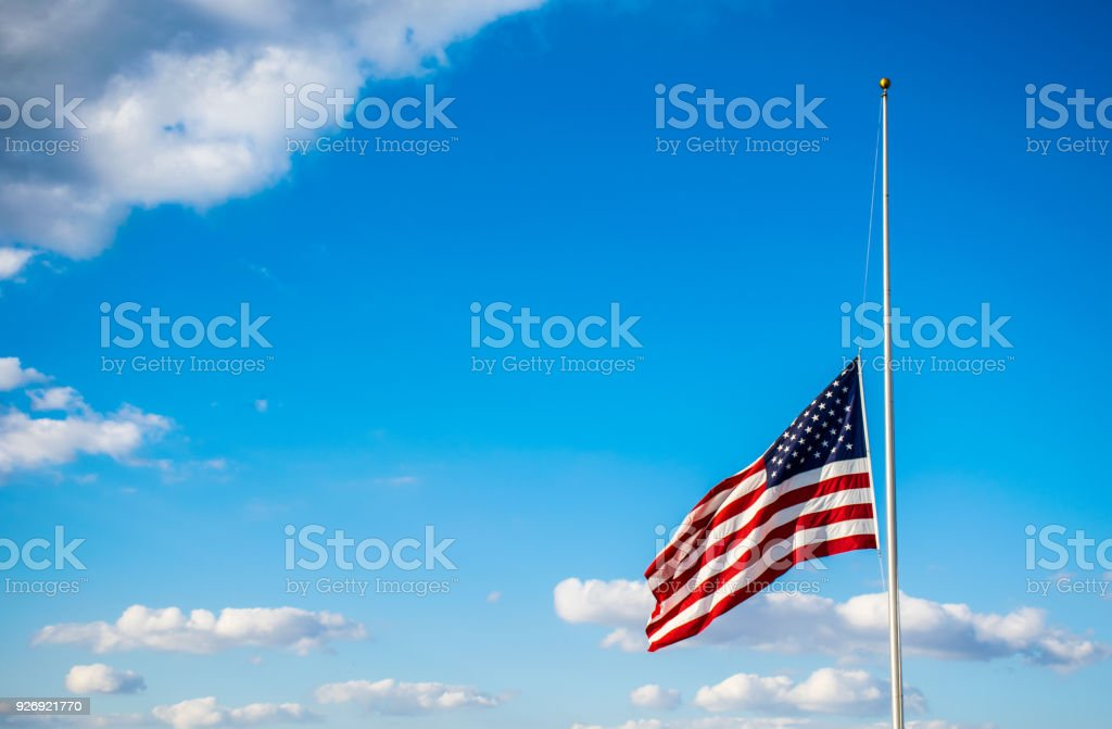 Perfect American Flag lowered to Half-Mast with Stars and Stripes stock photo