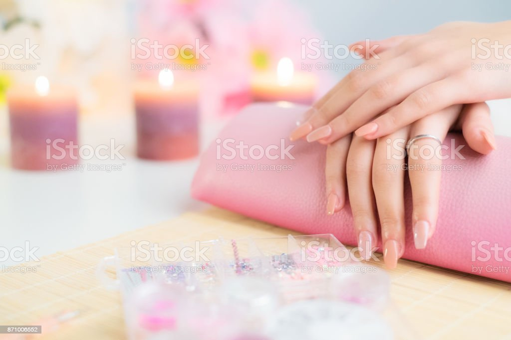 Perfect artificial fingernails of young woman stock photo