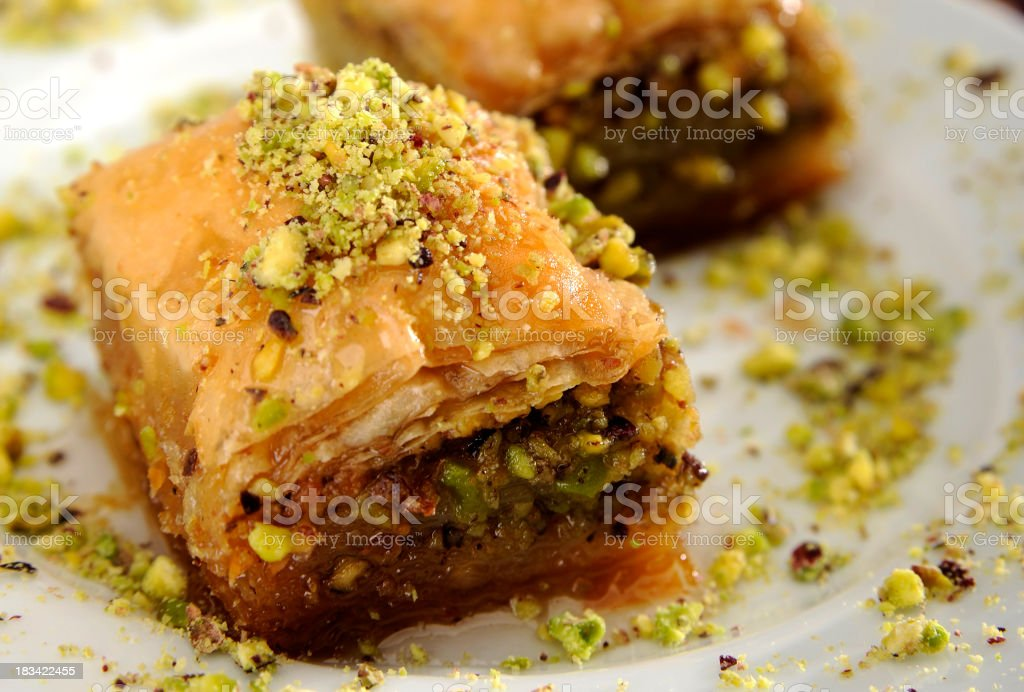 Perfect baklava with pistachio arranged on a white plate stock photo