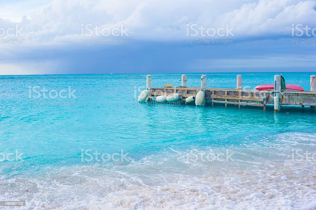 Perfect beach with pier at caribbean island stock photo