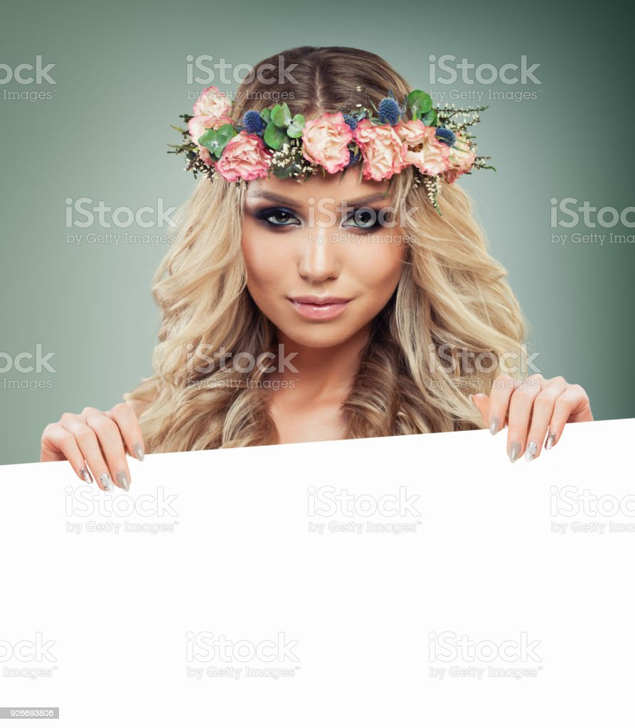 Perfect Blonde Woman Fashion Model with Blonde Curly Hair Holding White Paper Banner Background stock photo