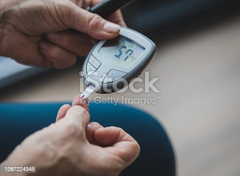 Woman measuring her blood sugar, with a great result of 5.7