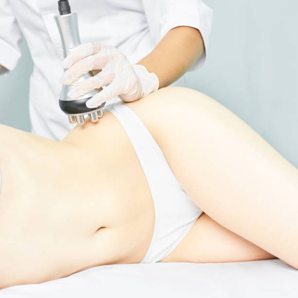 Perfect body radio treatment. Woman at spa procedure. Doctor hand and girl body. RF cosmetology lifting. Belly skin Perfect body radio treatment. Woman at spa procedure. Doctor hand and girl body. RF cosmetology lifting. Belly skin. tighten stock pictures, royalty-free photos & images