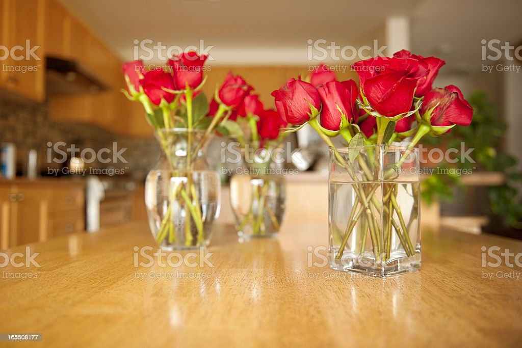 Perfect Bouquet of Roses, Three Vases, Kitchen Scene stock photo