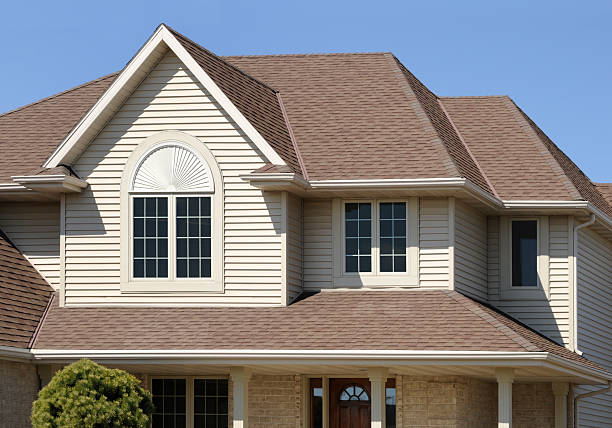 Perfect Brown Home With Gabled Architectural Asphalt Roof, Vinyl Siding stock photo