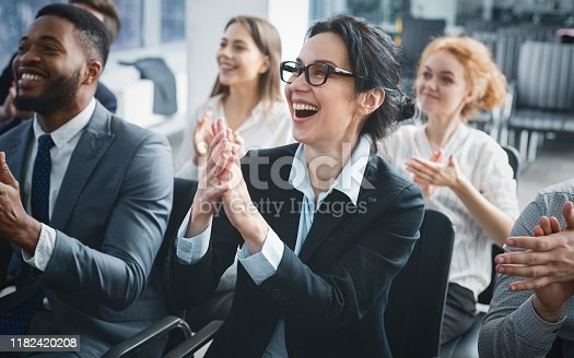 istock Perfect business lecture. Happy entrepreneurs applauding at conference 1182420208
