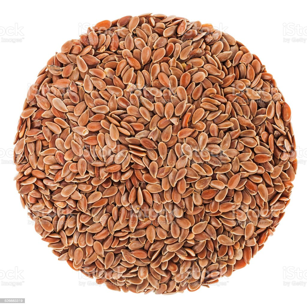 Perfect circle of Linseeds isolated on white stock photo
