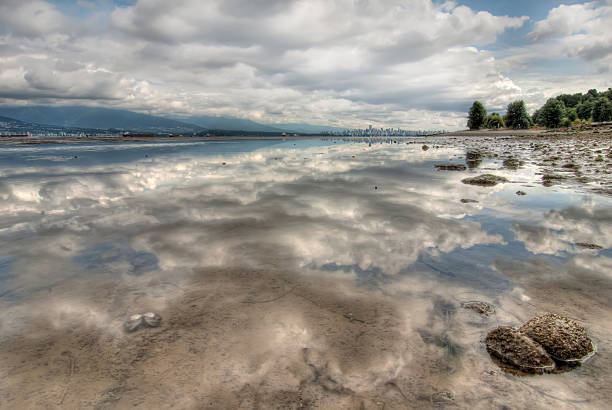 Perfect Clouds Reflection with Vancouver Skyline stock photo