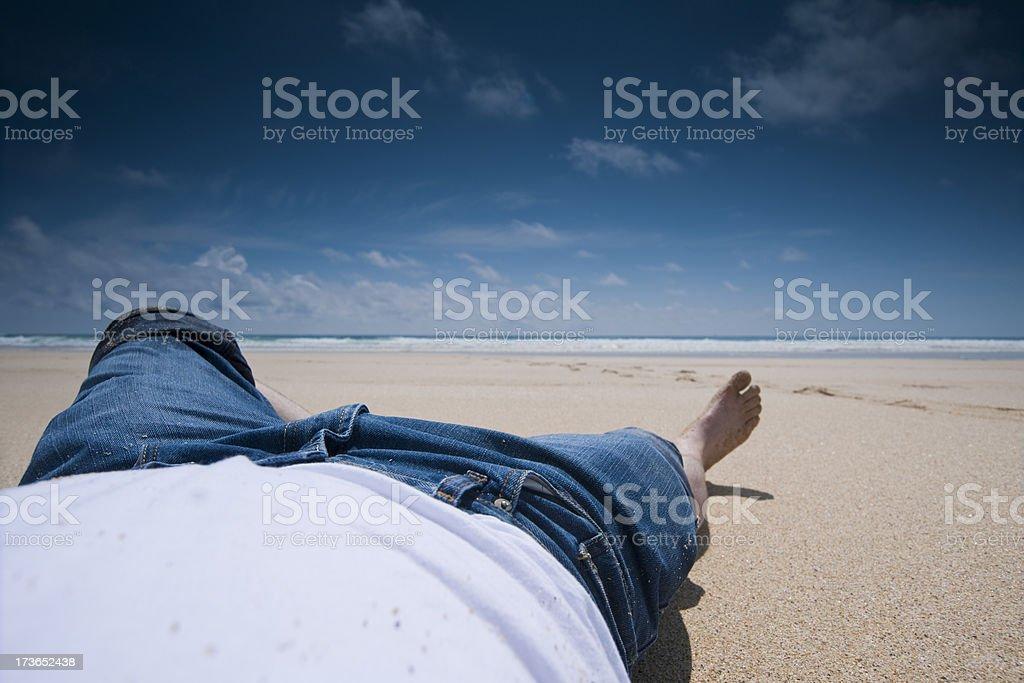 perfect day, man lying on a beautiful beach royalty-free stock photo