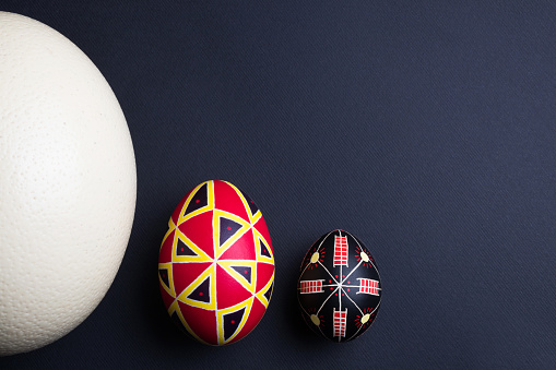 Perfect ethnical handmade easter eggs of different sizes. Decorated with traditional patterns. Festive mood. Copy space