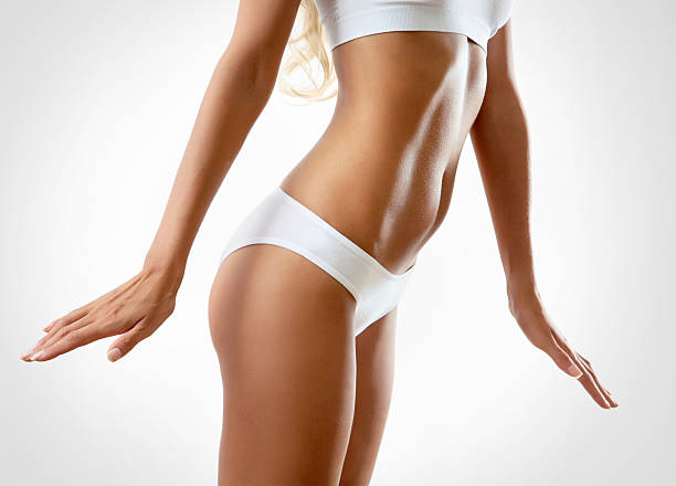 perfect female body - toned image stock photos and pictures