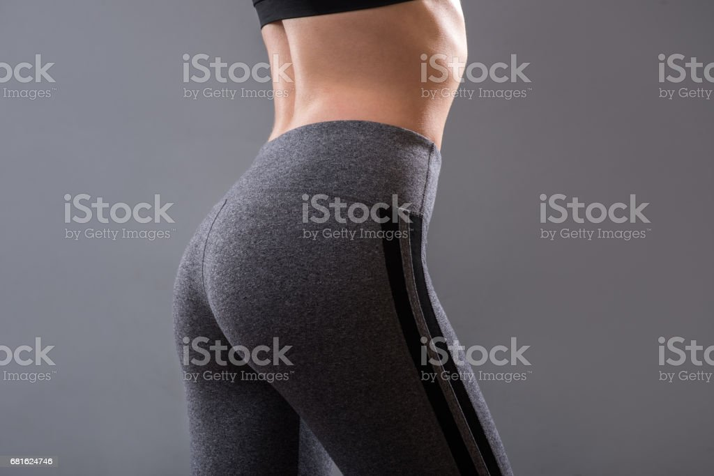 Perfect female buttocks of fitness girl stock photo