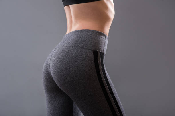 perfect female buttocks of fitness girl - buttock stock photos and pictures