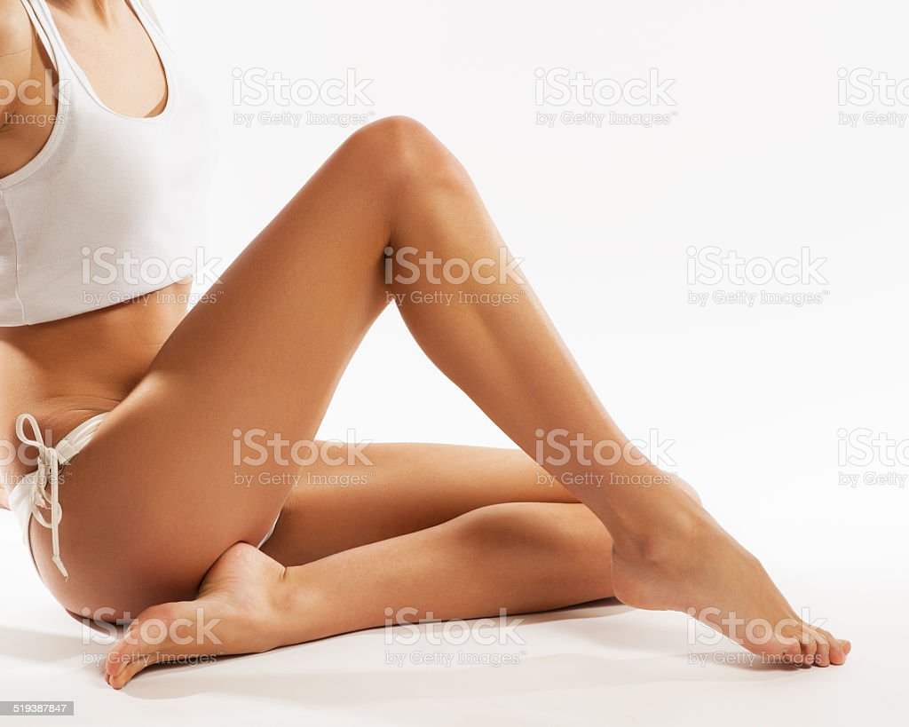 Perfect female legs, isolated on white background stock photo