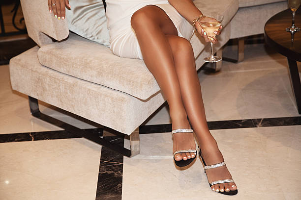 perfect female legs wearing high heels - black women wearing pantyhose stock photos and pictures