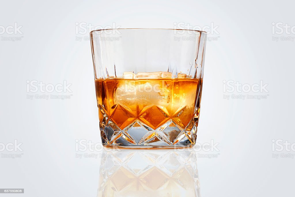 Perfect glass of whiskey and ice isolated stock photo