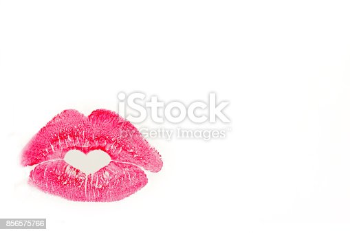 istock Perfect imprint of pink lipstick. Silhouette of pink lips isolated on white background. Qualitative trace of heart lipstick texture. Can be used as a decorative element for print or design. 856575766