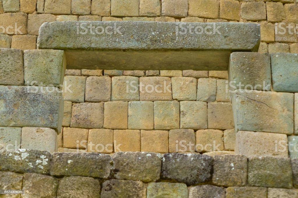 Perfect Inca wall viewed through stone window in Ingapirca stock photo