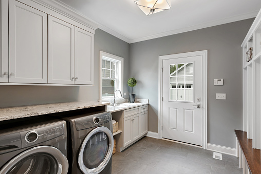 Large front loading washer and dryer in newly built home