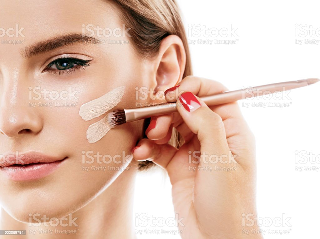 Perfect makeup. Skin tone cream lines on woman face. stok fotoğrafı