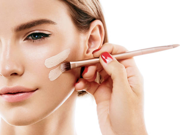 perfect makeup. skin tone cream lines on woman face. - solid stock photos and pictures